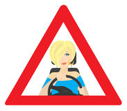 The blonde behind the wheel. The figure shows the blonde behind the wheel Stock Photo