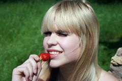 Blonde with berry Royalty Free Stock Image