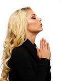 Blonde betende Frau Lizenzfreie Stockfotos