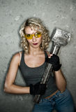Blonde with big metal hammer royalty free stock image