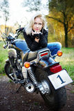 The blonde and big motorcycle Royalty Free Stock Image