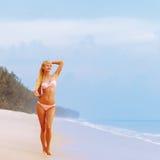Blonde in bikini on the beach. Royalty Free Stock Photos