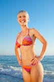 Blonde in bikini looking at camera smilin Stock Images