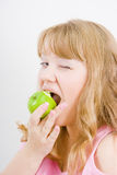 Blonde bites the apple Royalty Free Stock Photo