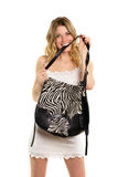 Blonde biting the strap of bag Royalty Free Stock Photos
