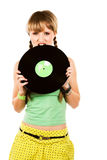 Blonde biting a vinyl record Royalty Free Stock Images
