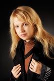 Blonde in black. A woman in a black cloak Stock Photos
