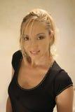 Blonde in black royalty free stock image