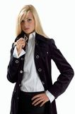 Blonde in black clothes. On white background Royalty Free Stock Photos