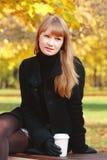 Blonde in black dress Stock Image