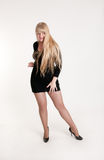 Blonde in a black dress Stock Images