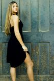 Blonde in Black Dress Stock Images
