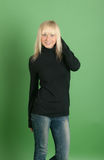 Blonde in a black jacket Stock Images
