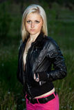 Blonde in a black leather jacket Stock Images