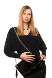Blonde with the black purse. Blonde in black with the black purse royalty free stock photo