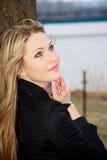 Blonde in black raincoat Royalty Free Stock Photo