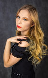Blonde in black. Sad blonde girl dressed in black with black nails Royalty Free Stock Photography