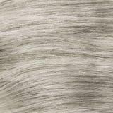 Blonde blanchie en bonne santé agrafe-dans la texture de cheveux photographie stock