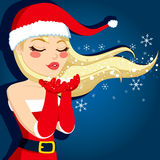 Blonde Blowing Christmas Magic Royalty Free Stock Photos