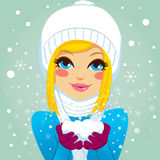 Blonde Blowing Snowflakes Royalty Free Stock Photos