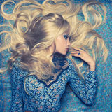 Blonde on Blue Royalty Free Stock Image
