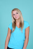 Blonde on blue looking up Royalty Free Stock Photo