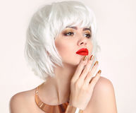 Blonde bob hairstyle. Blond hair. Fashion Beauty Girl portrait. Red lips. Manicured nails and Make-up. Jewelry set. Vogue Style Woman isolated on white Stock Photos