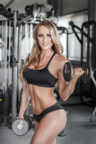 Blonde bodybuilder workout in gym Royalty Free Stock Photo