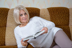 Blonde with a book Royalty Free Stock Images