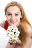 Blonde with a bouquet of chrysanthemums. A smiling beautiful blonde in red with a bouquet of white chrysanthemums in her hands Stock Photography