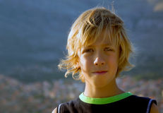 Blonde boy. Beautiful young boy with long blond hair Royalty Free Stock Photos