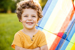 Blonde boy with arms crossed posing outside Royalty Free Stock Photo