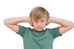Blonde boy covering his ears with his eyes closed. On white background royalty free stock photography