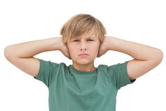 Blonde boy covering his ears Stock Photo