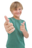 Blonde boy giving thumbs up and pointing Stock Images
