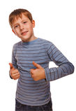 Blonde boy kid in striped jacket holding thumbs Stock Photos
