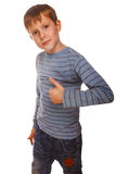 Blonde boy kid in striped jacket holding thumbs Stock Photo