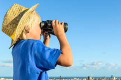 Blonde boy overlooking city Royalty Free Stock Images