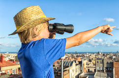 Blonde boy overlooking city Stock Photos