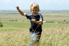 Blonde Boy Running Stock Photo