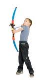 Blonde boy shooting a bow Stock Photo