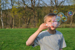 Blonde boy with soap bubbles Royalty Free Stock Images