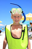 Blonde boy wearing snorkel gear at the beach. Portrait of a seven year old blonde caucasian boy wearing snorkel gear at the beach, head and shoulders only Stock Image