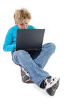 Blonde boy working with laptop royalty free stock photography
