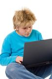 Blonde boy working with laptop Royalty Free Stock Images