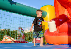 Blonde boy (7-9 years) in bouncy castle Royalty Free Stock Photos