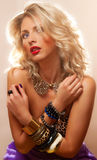 Blonde with bracelets. Beautiful blonde woman with fashion accessories Royalty Free Stock Photos