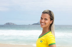 Blonde brazilian sports fan at beach is happy Stock Image