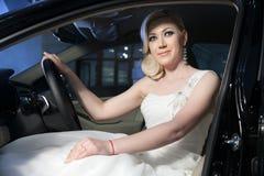 Blonde bride in a car Stock Photo
