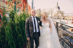 Blonde bride with her groom stock photos